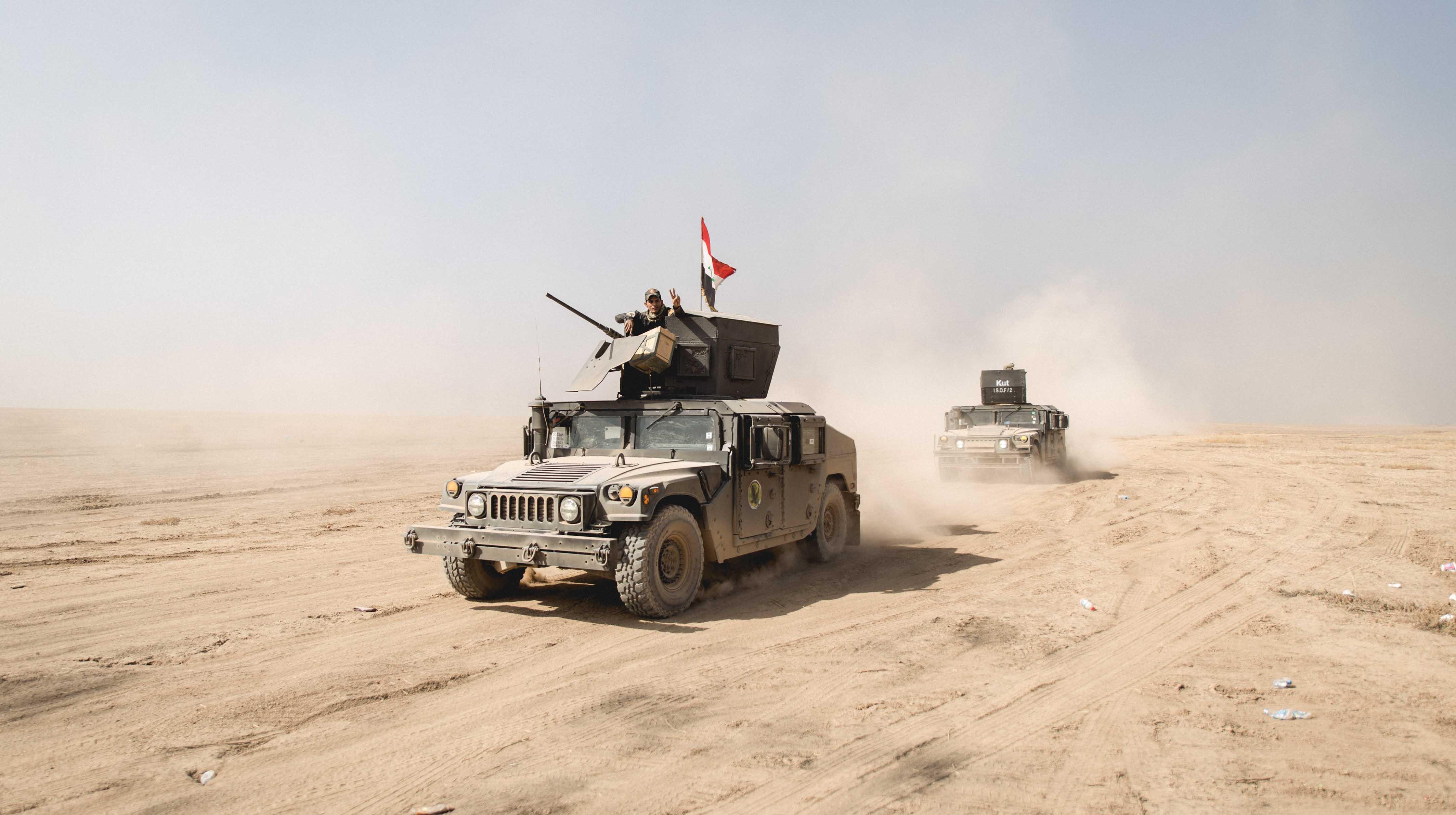 Le premier jour de l'offensive contre Mossoul s'est déroulé sous le contrôle des Peshmergas avec l'aide de la coalition. Certains villages ont été libéré du joug de l'Etat Islamique avant que l'armée irakienne vienne libérer les villages chrétiens dans les jours qui suivent. © Quentin Bruno / Hans Lucas